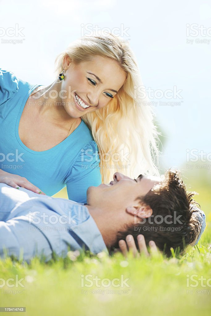 Young couple lying in park. royalty-free stock photo