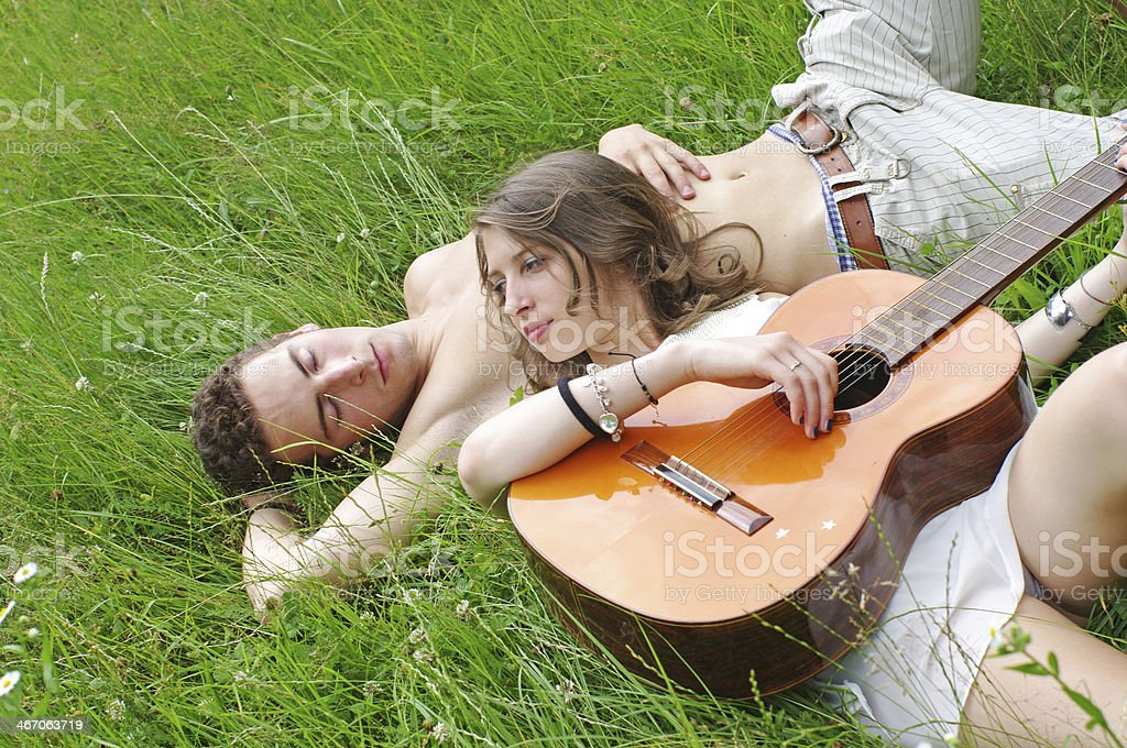 Young couple lying in park royalty-free stock photo