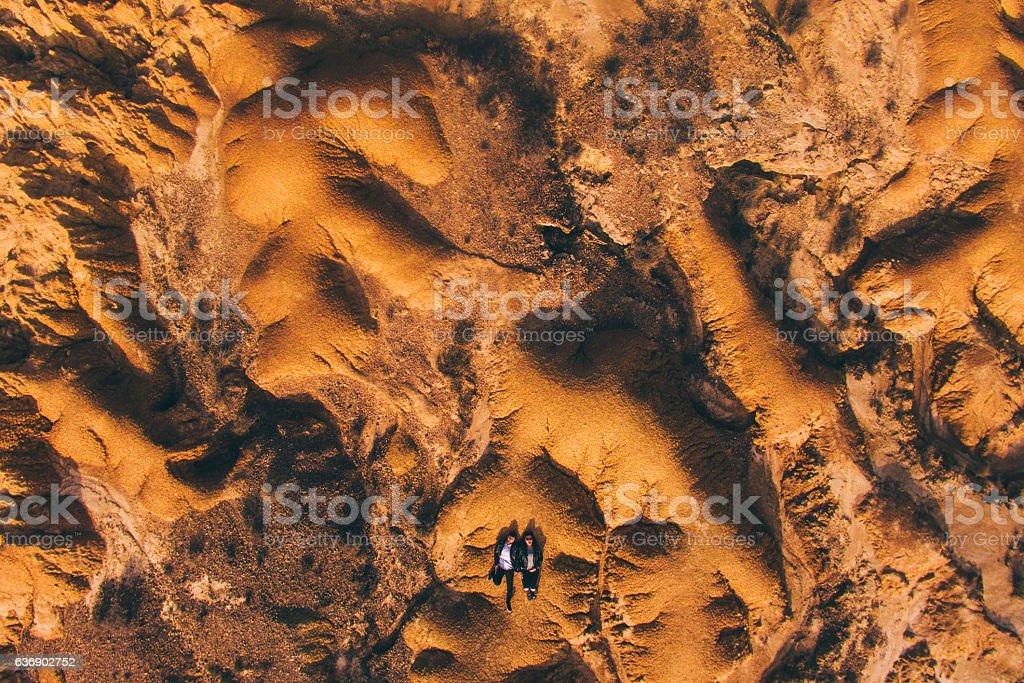 Young couple lying on desert stock photo