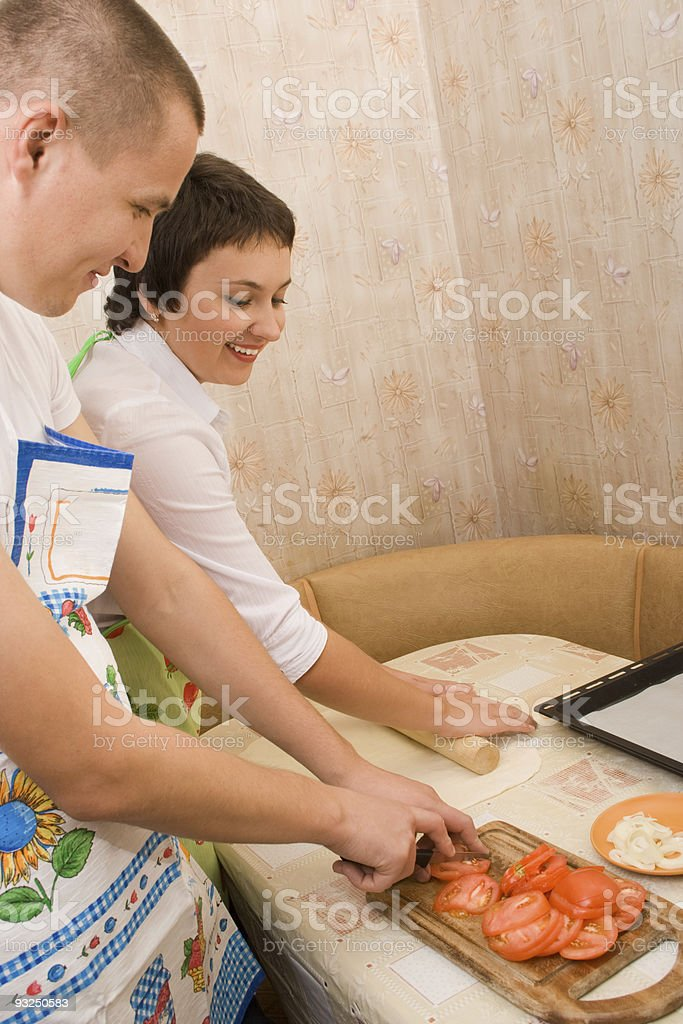 Young couple make a pizza stock photo