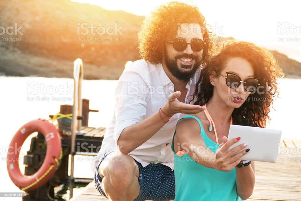 Young couple make selfie on the pier stock photo