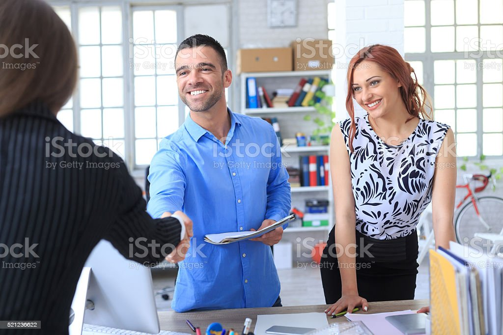 Young couple making a deal stock photo