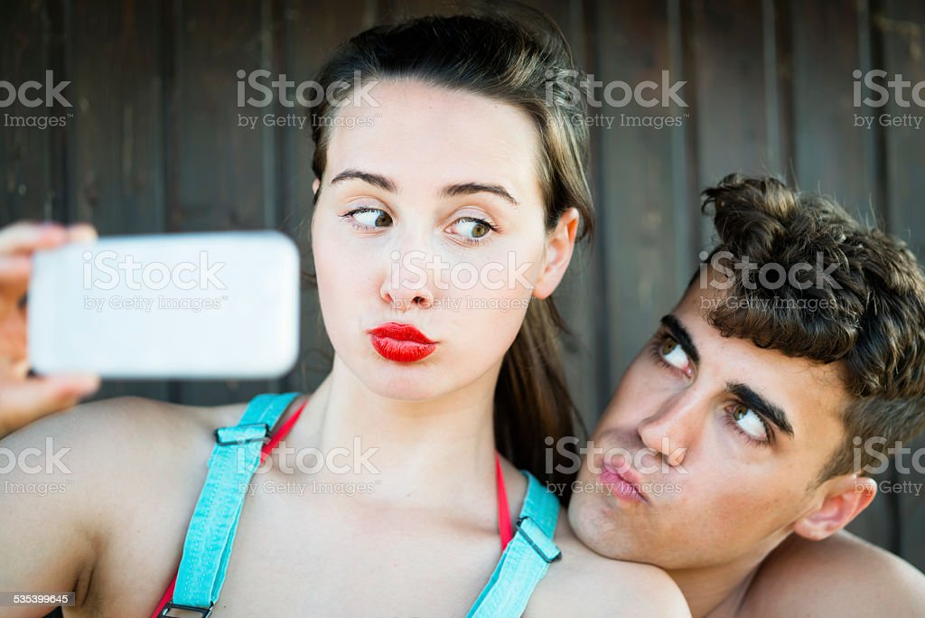 Young Couple Making Faces While Taking Selfie, Summer, Portorose, Europe stock photo