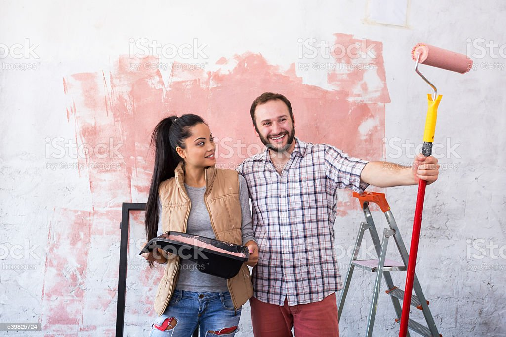 Young couple making home redecoration stock photo