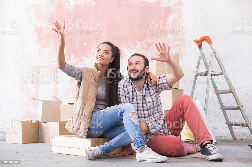 Young couple making plans for home improvement stock photo