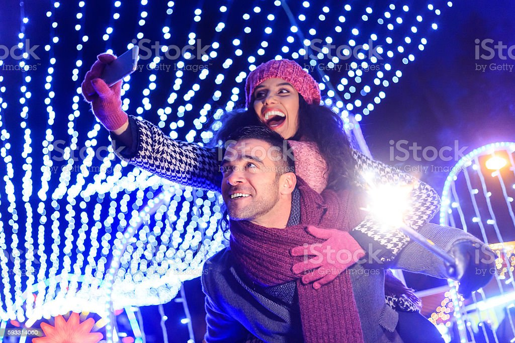 Young couple making selfie at night stock photo