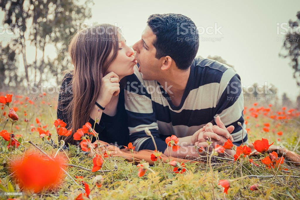 Young  couple making silly faces to each other stock photo