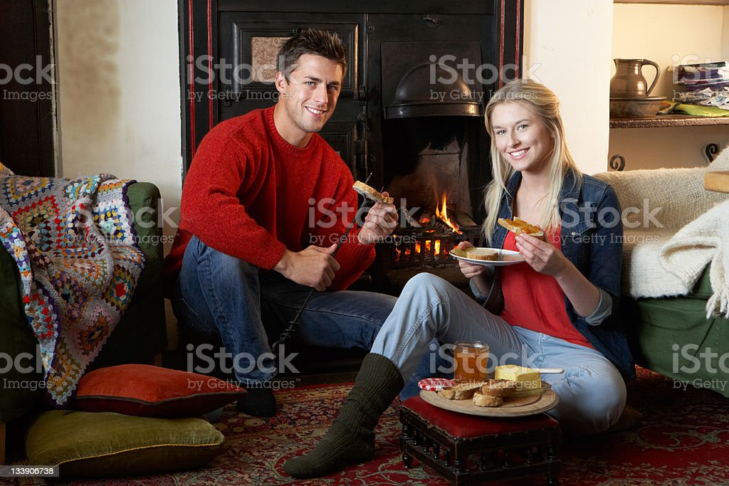 Young couple making toast on open fire royalty-free stock photo
