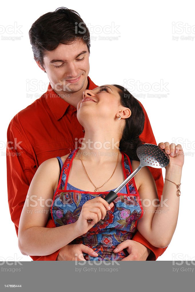 Young couple, man and housewife, embraces. royalty-free stock photo