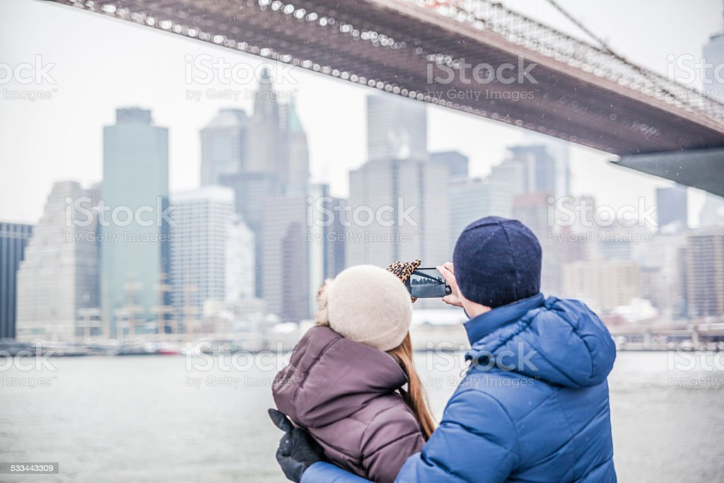 Young couple, man and woman, make photos of Manhattan stock photo