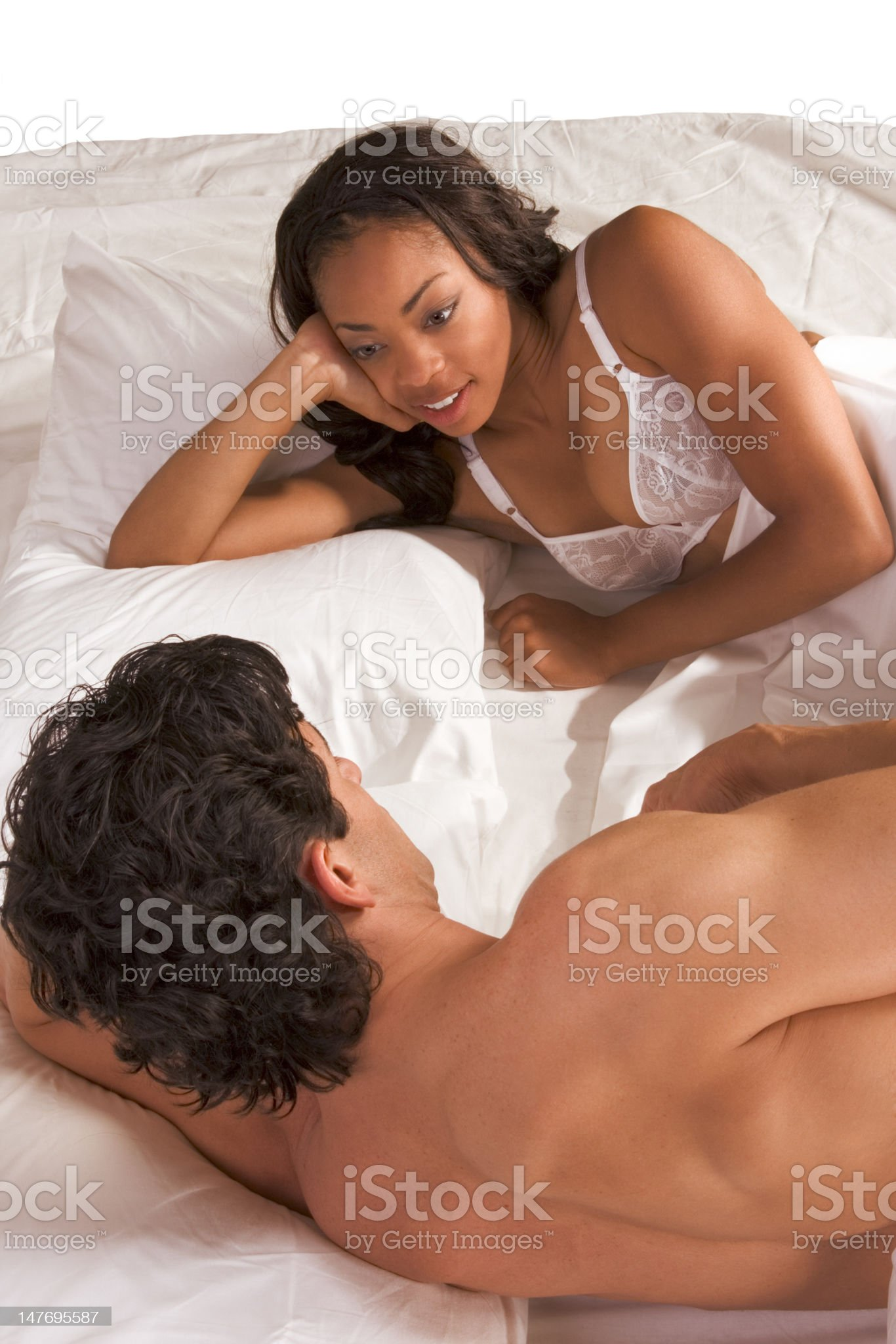 Young couple Man and woman talking in bed royalty-free stock photo