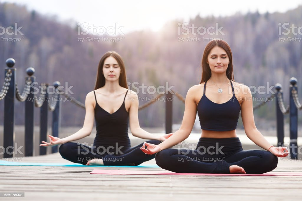 Young couple meditating together stock photo