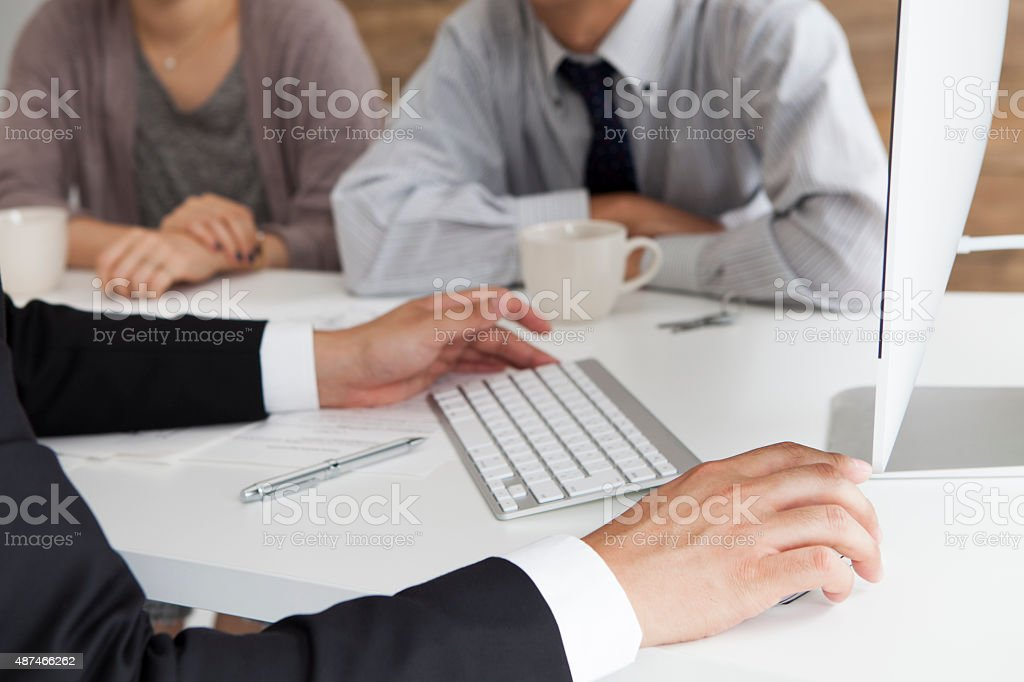 Young couple meeting financial consultant for credit loan stock photo