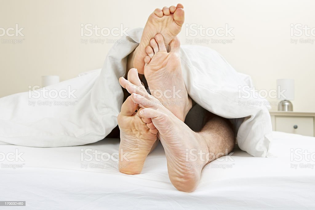 Young couple messing in bed stock photo
