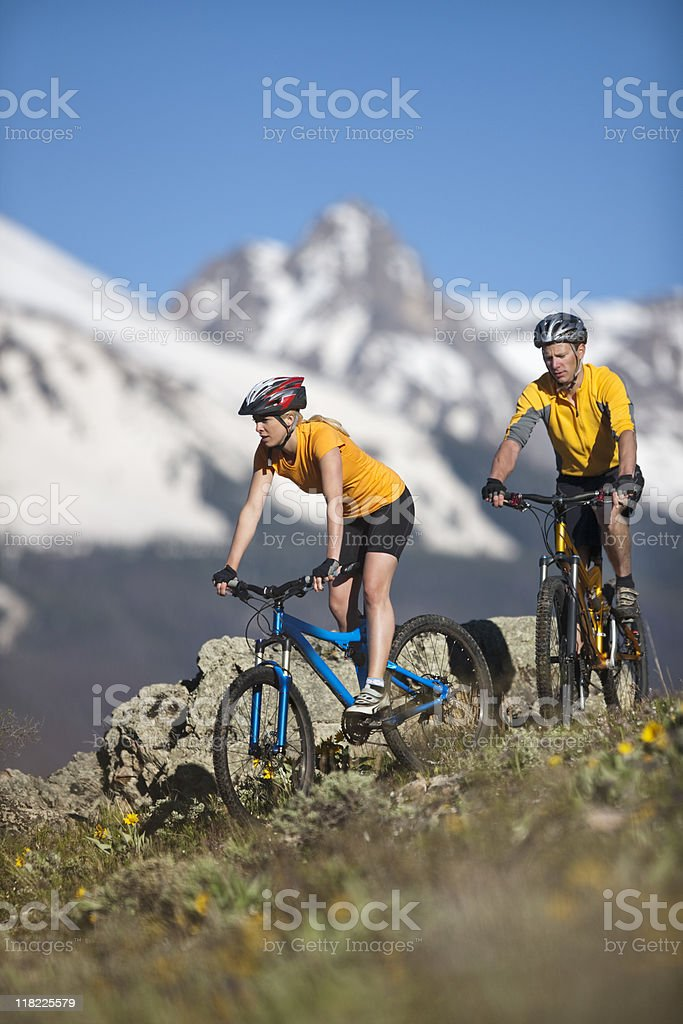 Young Couple  Mountain Biking In Foothills Of Rocky Mountains royalty-free stock photo
