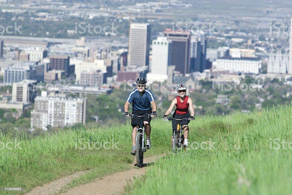 Young Couple Mountain Biking royalty-free stock photo