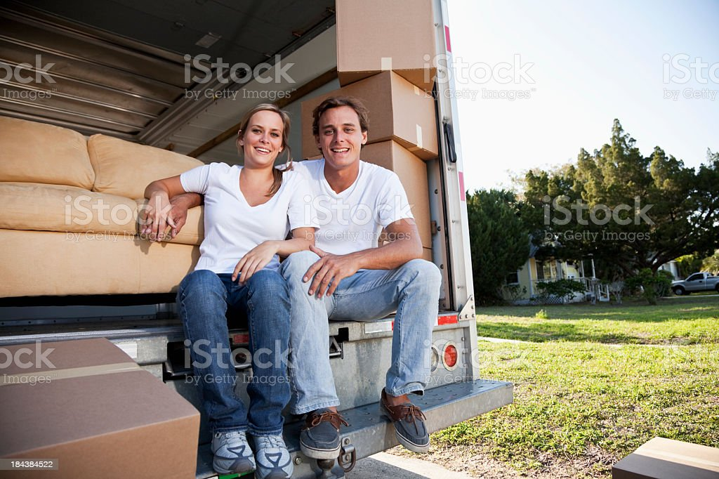Young couple moving house, taking a break stock photo