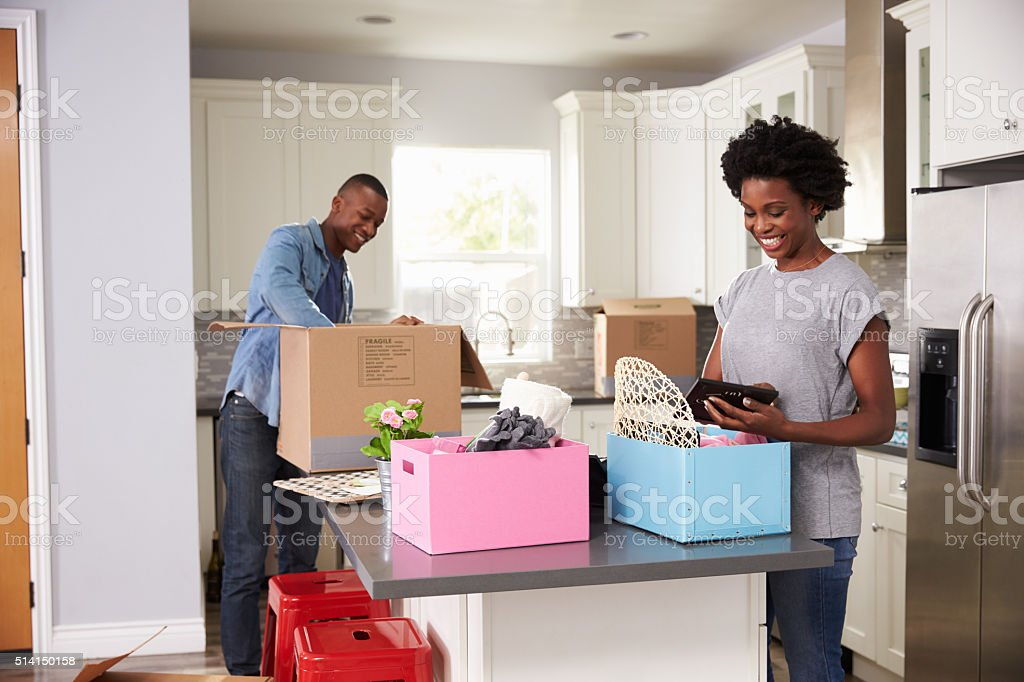 Young Couple Moving In To New Home Together stock photo