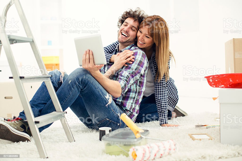 Young couple moving in together. stock photo