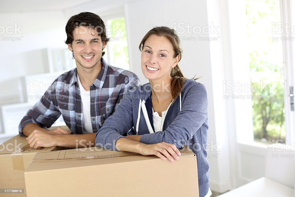 Young couple moving into a new home stock photo