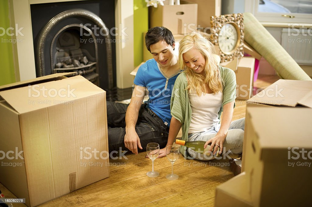 Young Couple Moving into a New Home royalty-free stock photo