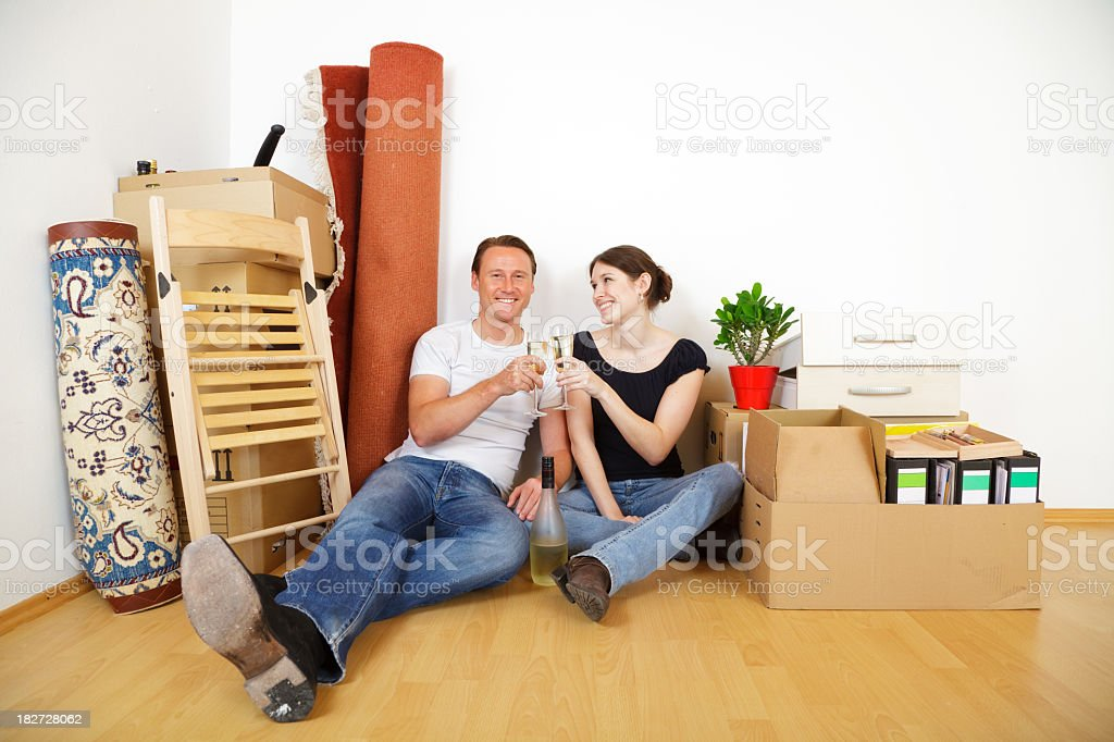 young couple moving stock photo