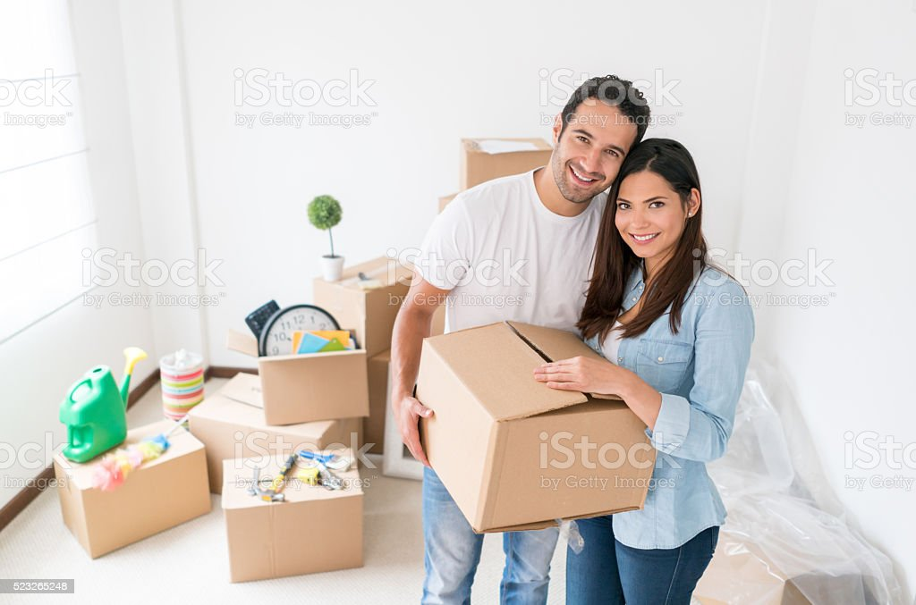 Young couple moving to a new house stock photo