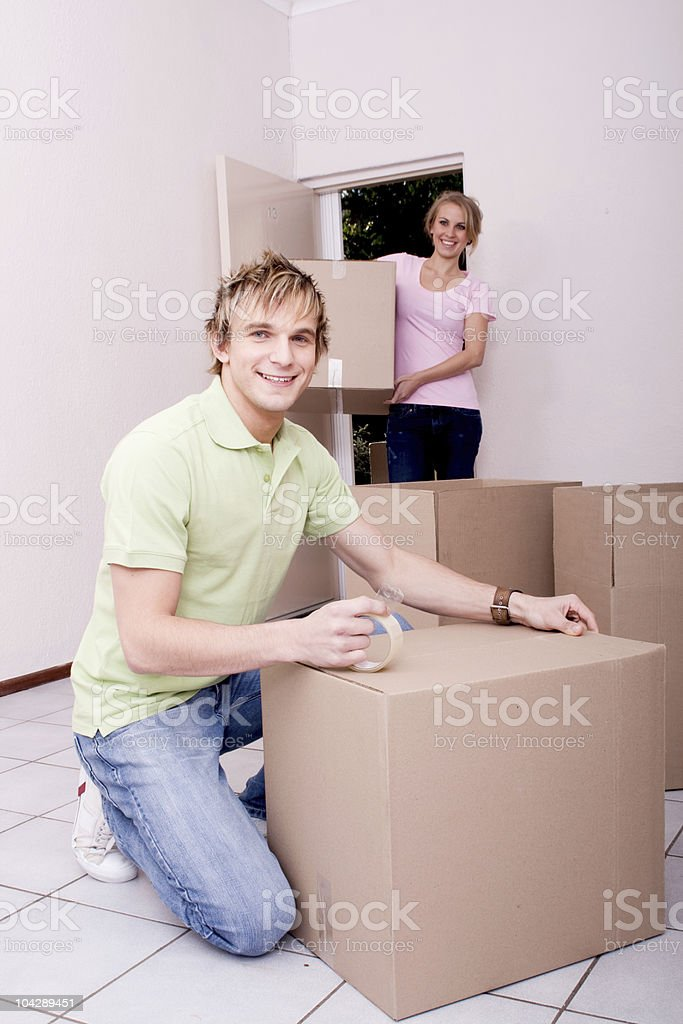 young couple moving to new home royalty-free stock photo