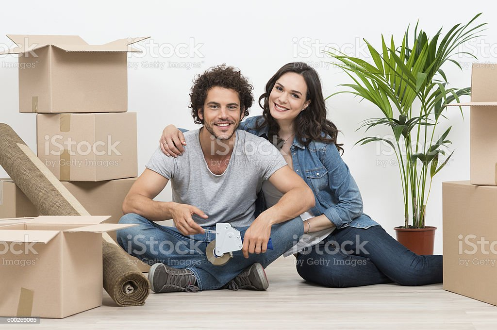 Young Couple Moving To New House stock photo