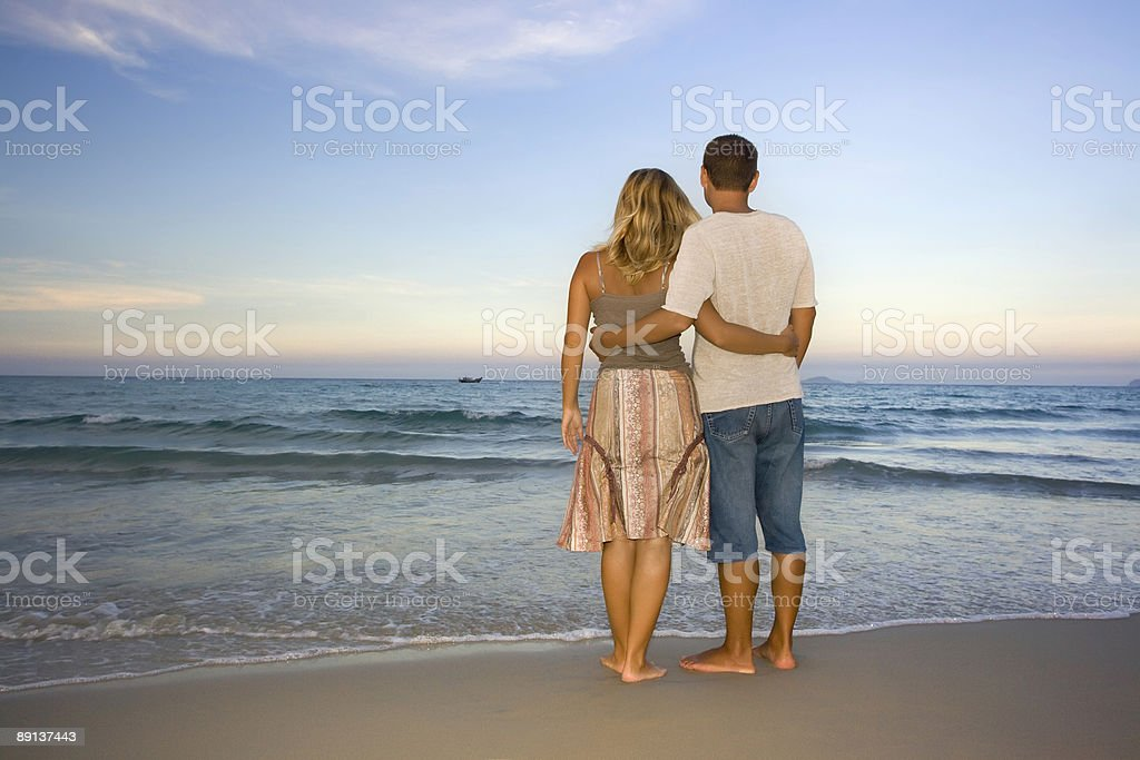Young couple near the ocean royalty-free stock photo