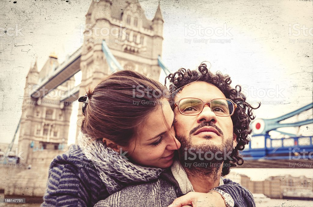 Young Couple Near Tower Bridge In London stock photo