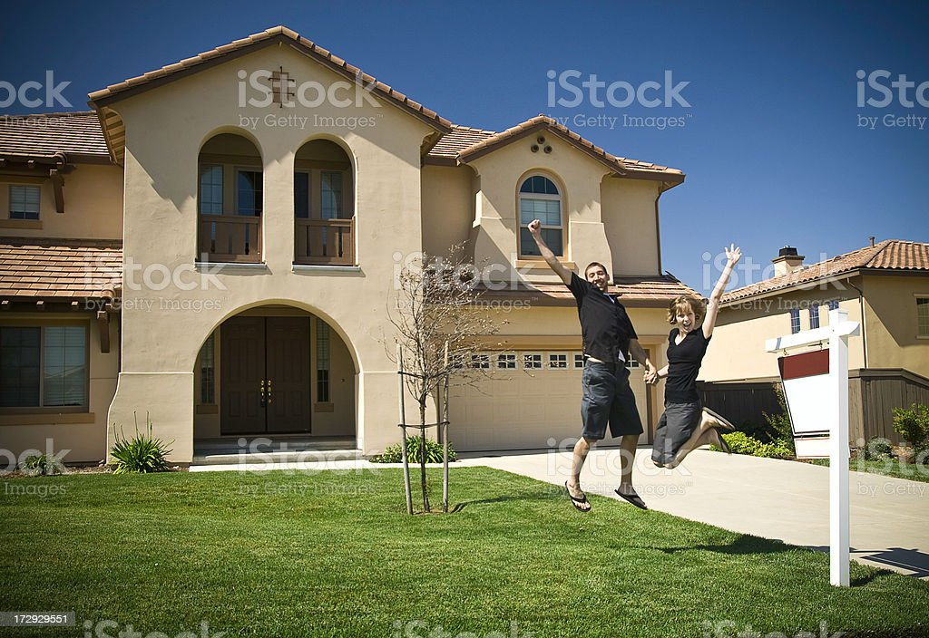 Young Couple New Home Celebration stock photo
