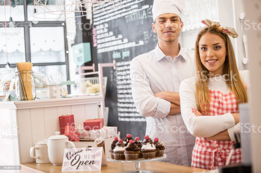 Young couple of small business owners stock photo