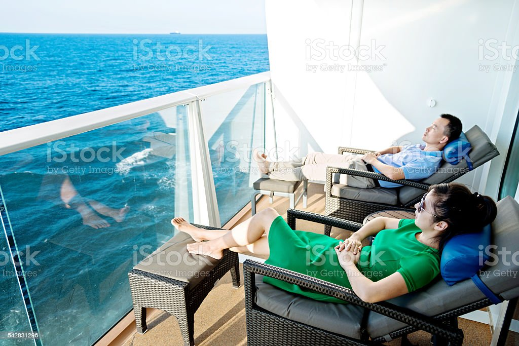 Young couple on a cruise ship stock photo