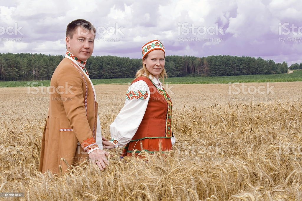 Young couple on a field. royalty-free stock photo