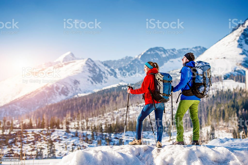 Young couple on a hike stock photo