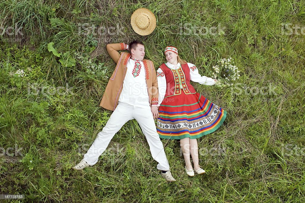 Young couple on a meadow. royalty-free stock photo