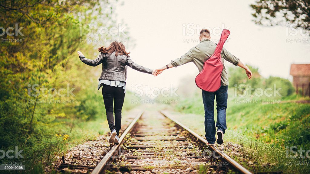 Young couple on a railway tracks stock photo