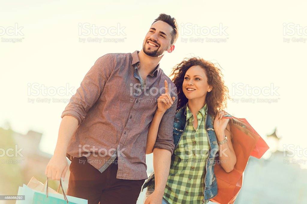 Young couple on a shopping trip stock photo