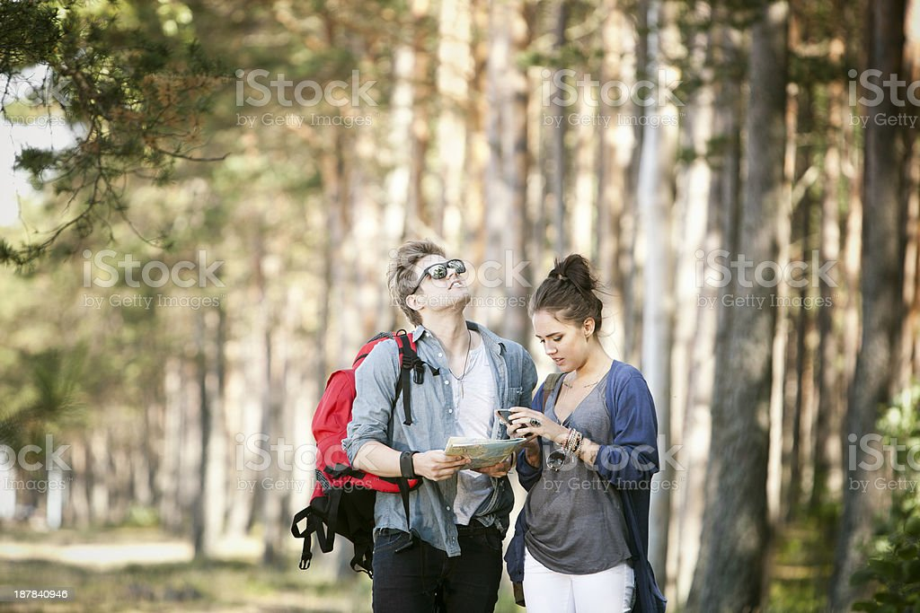Young Couple on Adventure, looking for directions. royalty-free stock photo
