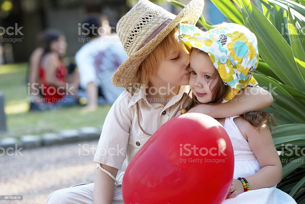 Young couple on avenue in park royalty-free stock photo