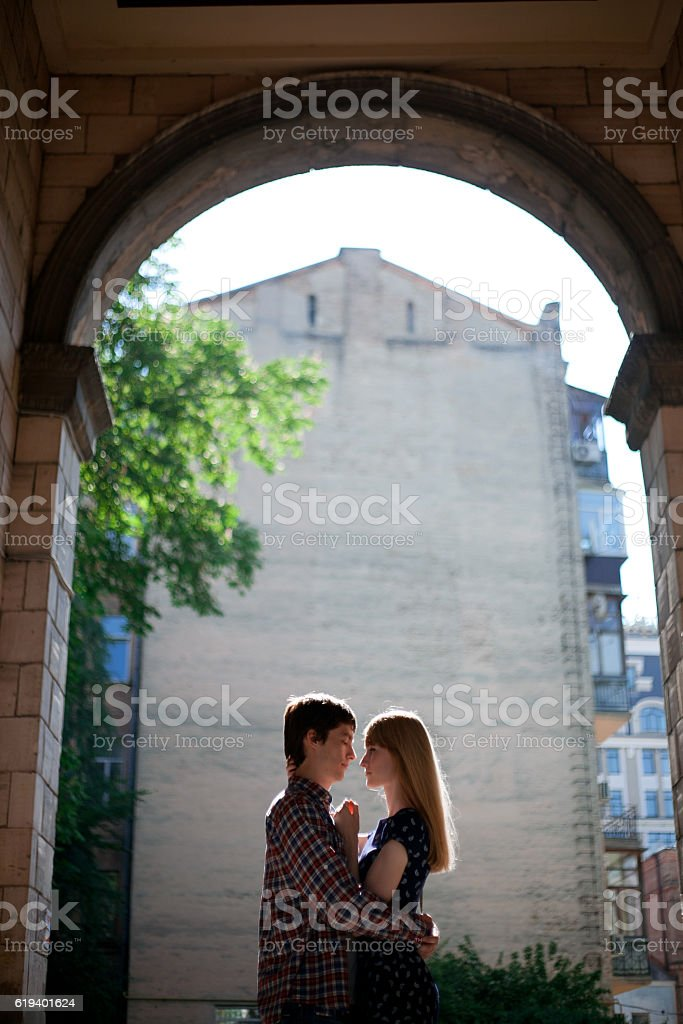 young couple on background of architecture arch stock photo