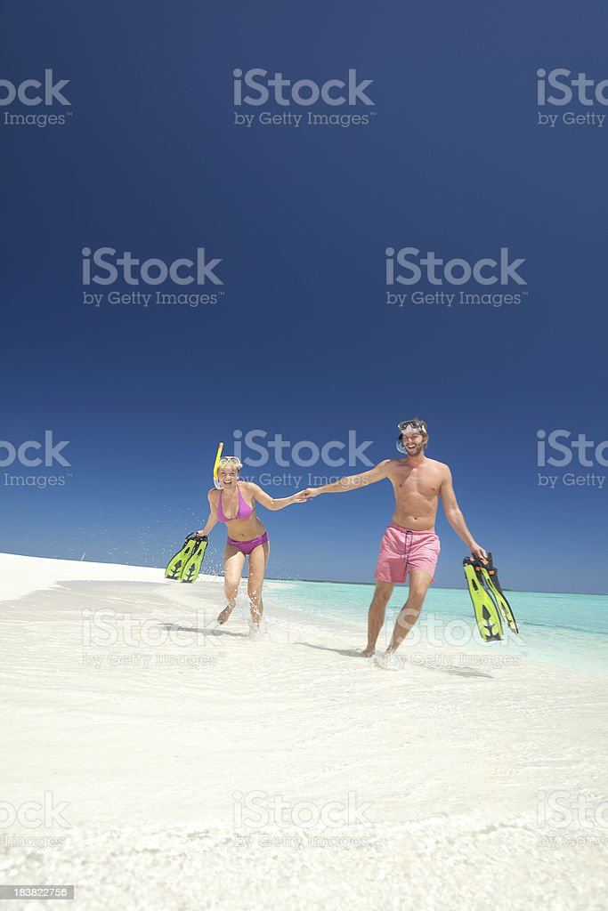 young couple on beach after snorkeling royalty-free stock photo