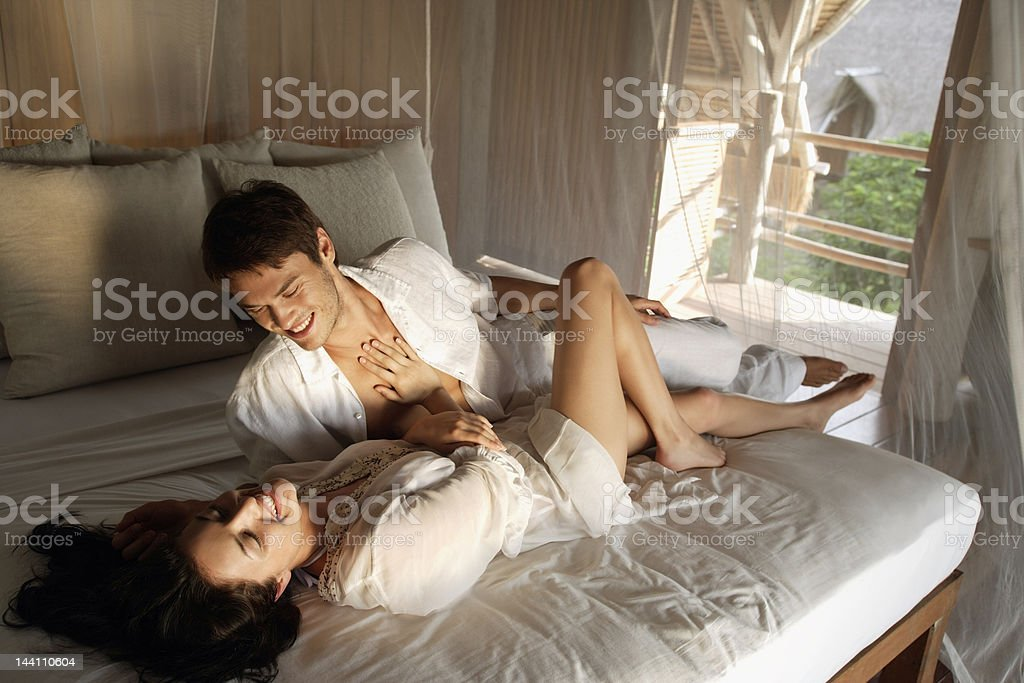 young couple on bed royalty-free stock photo