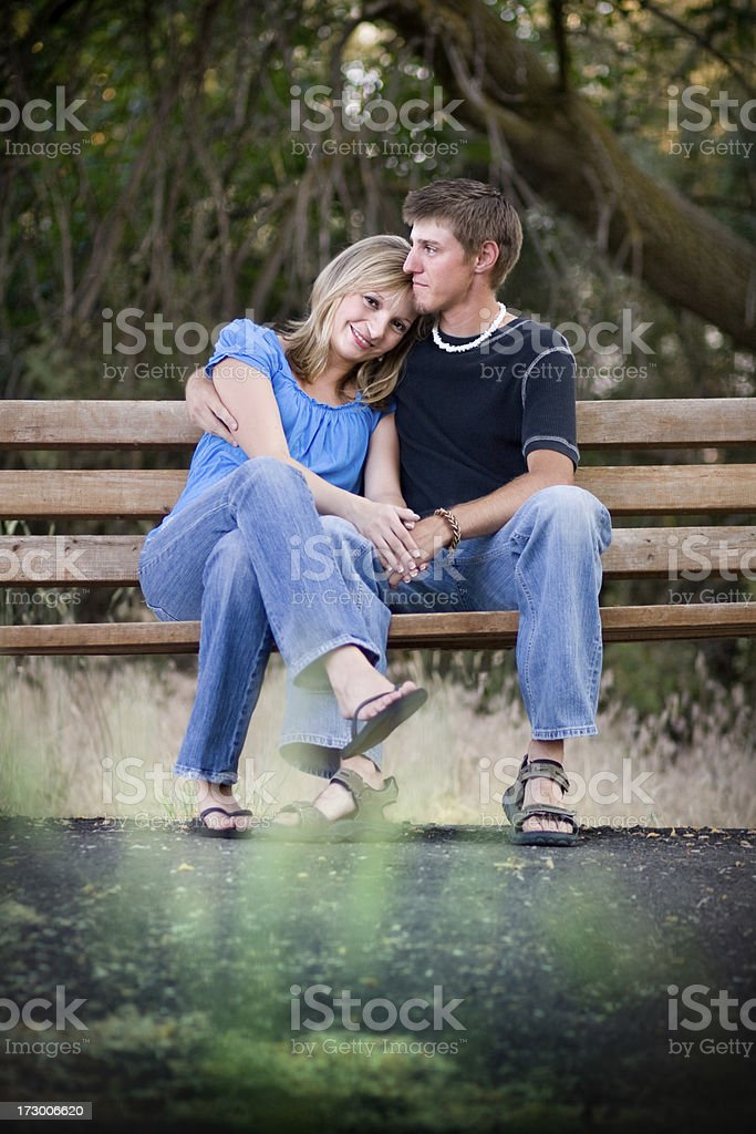 Young Couple on Bench royalty-free stock photo