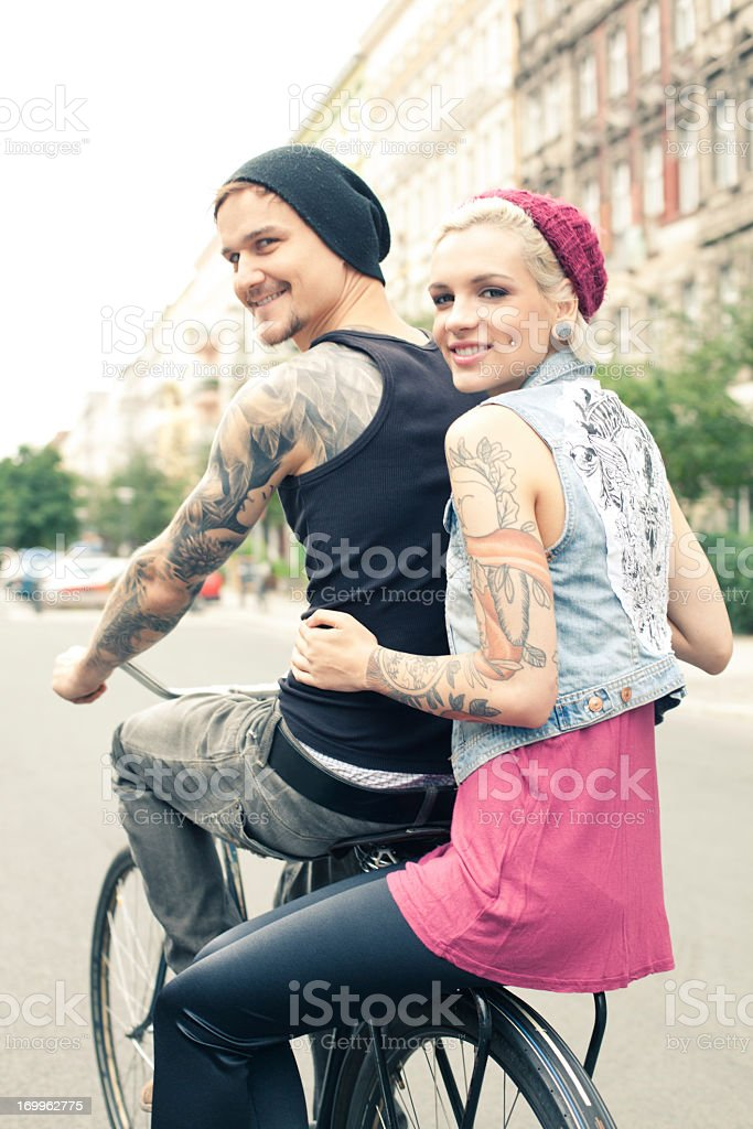 Young couple on bicycle stock photo