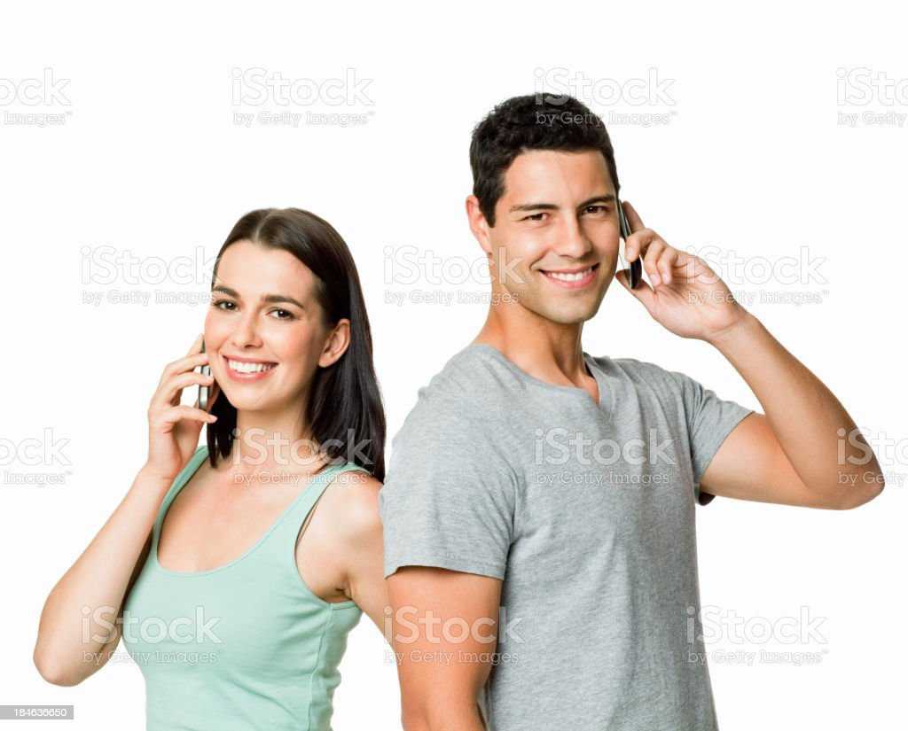 Young Couple on Cellphones - Isolated royalty-free stock photo