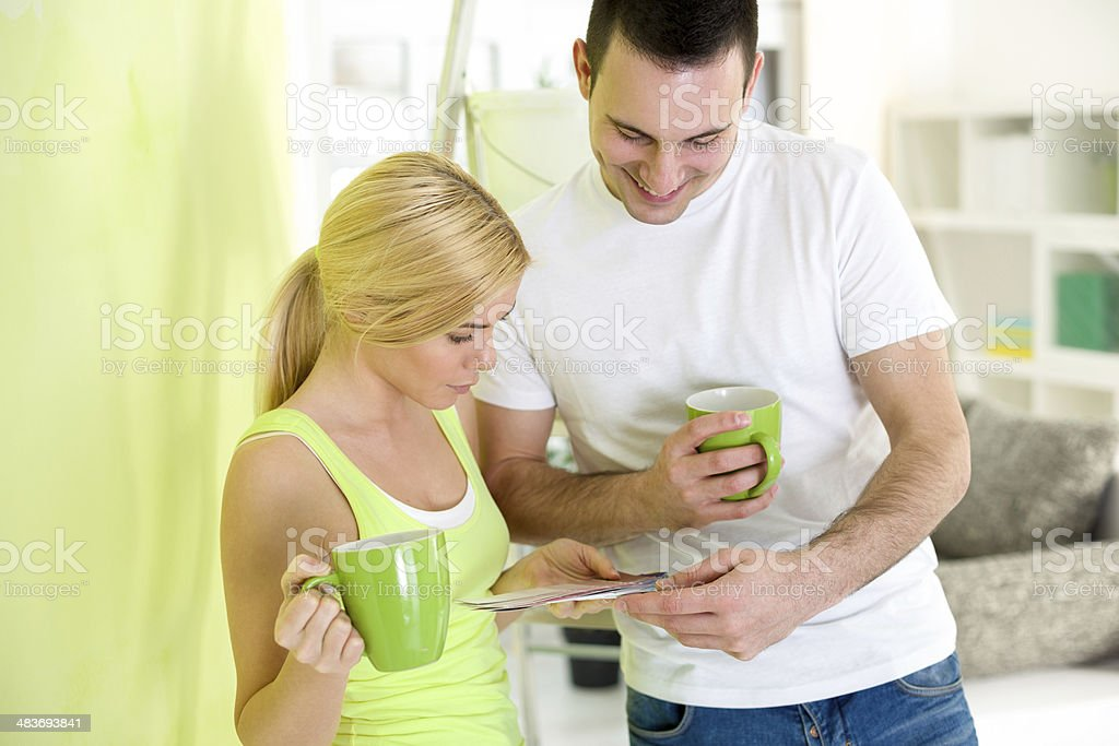 Young couple on coffee break  while painting royalty-free stock photo