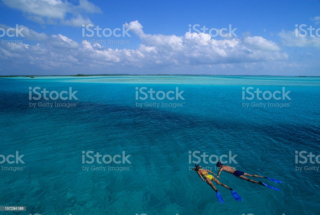 Young Couple On Holiday Snorkeling off Island stock photo