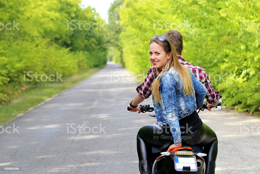 young couple on motorcycle stock photo